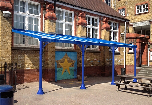 Full width shot of a blue victorian style carport